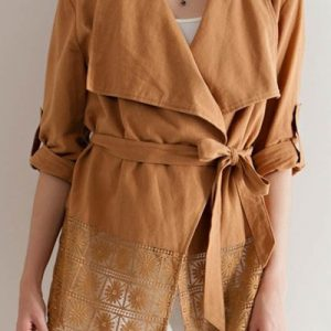 A solid woven wrap jacket featuring lace detail on hem. Roll-up sleeves. Tie-up belt on waist. Woven.